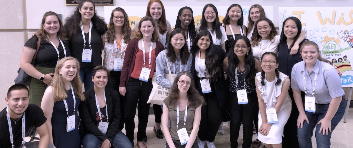 A group of undergraduate college students and their faculty mentor posing for a picture during the Grace Hopper Celebration held in 2019